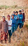 Group of farmers standing around an agricultural field. Some people standing around an agricultural paddy field isolated unique editorial photograph stock photography