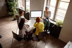 Group of fashion designer working and talking at studio. Group of young fashion designer working and talking at studio royalty free stock image