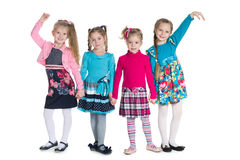 Group of fashion little girls. Stand on the white background royalty free stock image