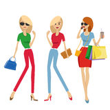 Group of fashion women with shopping bags and handbags Royalty Free Stock Photos