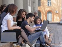 Group of fellow students with books and laptop. Education concept Royalty Free Stock Images