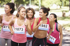 Group Of Female Athletes Competing In Charity Marathon Race Stock Photography