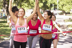 Group Of Female Athletes Completing  Charity Marathon Race Royalty Free Stock Photography