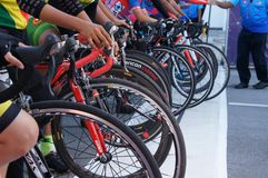 Group of female cyclists are ready to be on the starting line. KUALA LUMPUR, MALAYSIA -MARCH 16, 2019: Group of female cyclists are ready to be on the starting stock image