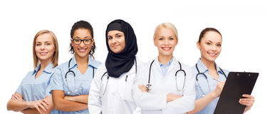 Group of female doctors with clipboard Royalty Free Stock Photos