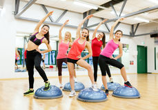Group of female doing aerobics with half ball Stock Image