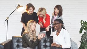Group of female fashion professionals working on design clothes sitting at table stock footage