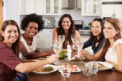 Group Of Female Friends Enjoying Dinner Party At Home Stock Photos