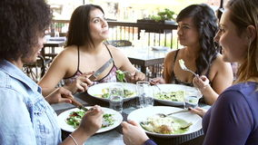 Group Of Female Friends Enjoying Meal At Outdoor Restaurant stock video footage