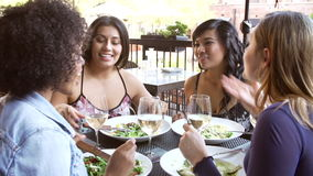 Group Of Female Friends Enjoying Meal At Outdoor Restaurant stock footage