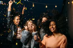 Group of female friends enjoying night party Royalty Free Stock Images