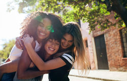 Group of female friends enjoying outdoors on city street royalty free stock image
