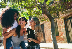 Group of female friends having fun on city street Royalty Free Stock Images