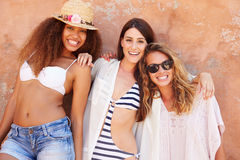 Group Of Female Friends On Holiday Together Posing By Wall Royalty Free Stock Image