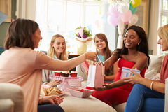 Group Of Female Friends Meeting For Baby Shower At Home Stock Photo