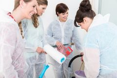 Group of female friends renovating the house royalty free stock images