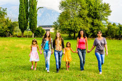 Group of female friends walking walking through the park Royalty Free Stock Images