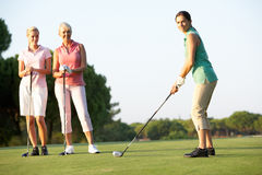 Group Of Female Golfers Teeing Off. On Golf Course royalty free stock photos