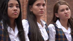 Serious Disappointed Teen Girls. A Group of Female High School Students Royalty Free Stock Image