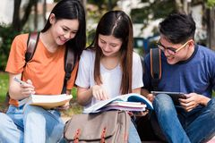 Group of female and male students together. To consult reading at university, Education concept Stock Image
