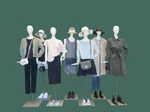 Group of female mannequins wear fashion clothing. Group of female mannequins wear fashion clothing isolated on blue background. No brand names or copyright stock images