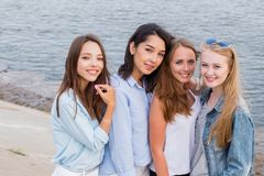 Group of female students posing together outdoor and looking at camera stock photo