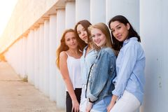 Group of female students posing together outdoor and looking at camera royalty free stock photography