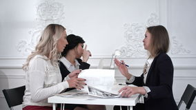 Group of female young business people in a meeting at office.Timelaps stock footage