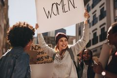 Group of females activist protesting royalty free stock images