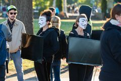 Group of females with Guy Fawkes masks stock image