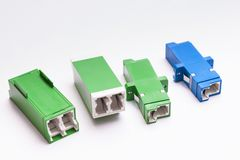 Group of fiber optic adapters SC and LS Royalty Free Stock Photos