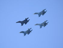 A group of fighters performs a rhombus flight stock photo