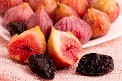 Group of figs and plums in a white plate Stock Photo