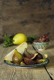 Group of figs on rustic wooden table Stock Image