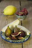 Group of figs on rustic wooden table Stock Images