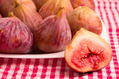 Group of figs in a white plate Stock Photos