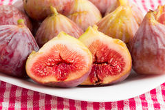 Group of figs in a white plate Stock Image