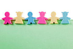 Group of figurines on blank paper Stock Photos