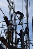 A group of Filipino Construction steel workers assembling steel bars on high-rise building with no proper protective suits and saf. San Pablo City, Laguna Royalty Free Stock Photo
