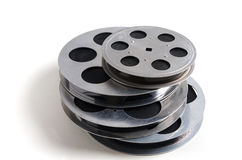 Group of film reels cinematography. With cinema accessories on white background royalty free stock images