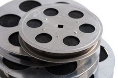 Group of film reels cinematography closeup. With cinema accessories on white background stock images