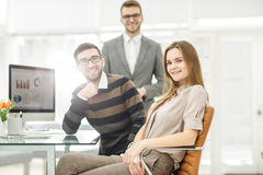 Group of financial experts work with financial reports at the workplace. Team of copywriters working on a new advertising project in the workplace in the Studio Stock Image