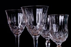 Group of finely chiseled alcohool glasses, close up with black b. Ackground royalty free stock image