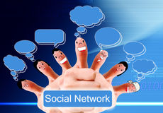 Group of finger faces as social network. Social network concept of Happy group of finger faces with speech bubbles Royalty Free Stock Photo
