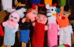 Finger Puppets. A group of finger puppets handmade from yarn stock image