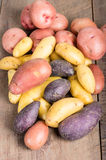 Group of fingerling potatoes on wooden table Stock Images