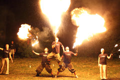 Group of fire jugglers Royalty Free Stock Photo