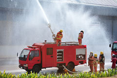 Group of firefighters man are inject spray the water to fire acc Stock Photo