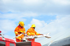 Group of firefighters man are inject spray the water to fire acc Royalty Free Stock Photo