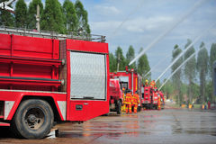 Group of firefighters man are inject spray the water to fire acc Stock Image